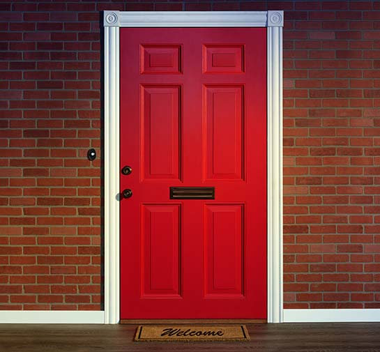 Red Entry Door Along With A White Trim