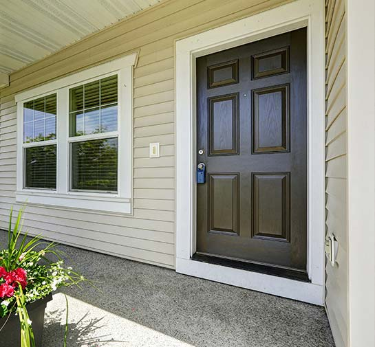 a brown exterior front door