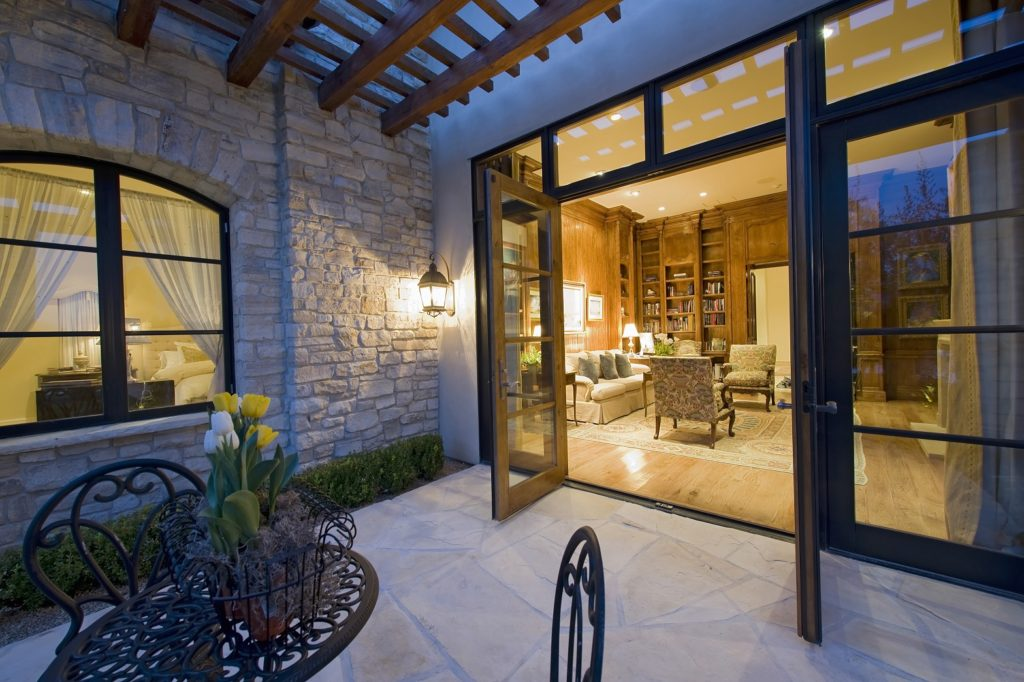 open patio doors leading out to tiled patio, with a peak into an elegant living room